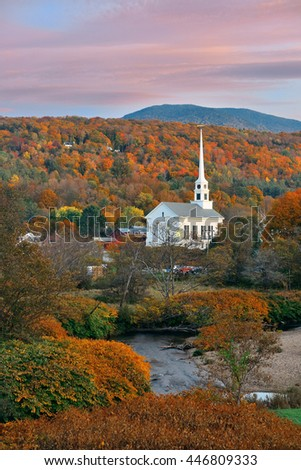 Stowe at sunset in Autumn with colorful foliage and community church in Vermont - stock photo