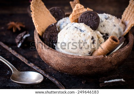Stracciatella ice cream and cookies in the wooden bowl,selective focus - stock photo