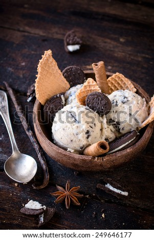 Stracciatella ice cream with cookies on wooden background,selective focus - stock photo