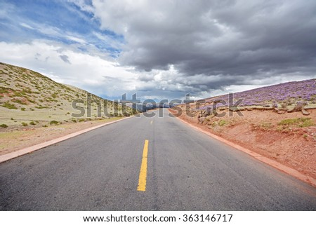straight highway road with storm cloud  - stock photo