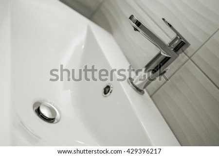 Straight on close up of modern bathroom sink - stock photo