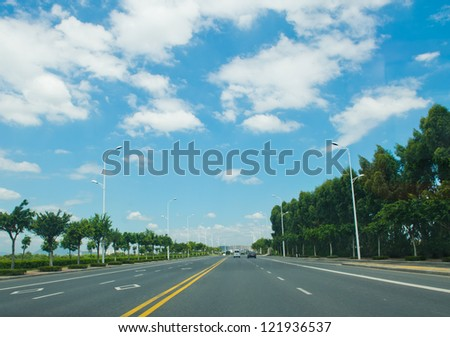 straight road and sky in the city. - stock photo