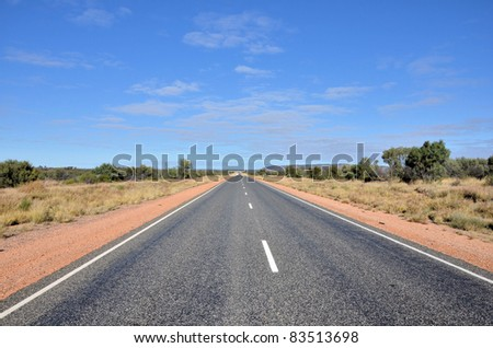 Straight Road in the Australian Outback - stock photo