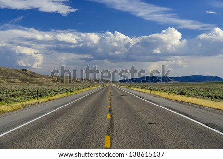 Straight roadway leading on forever in Cokeville, Wyoming, USA - stock photo