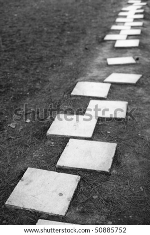 Strait path made of marble stepping stones - stock photo