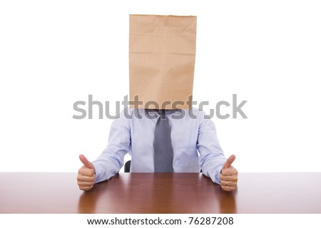 Strange business man with a cardboard bag on the head showing thumbs up - stock photo