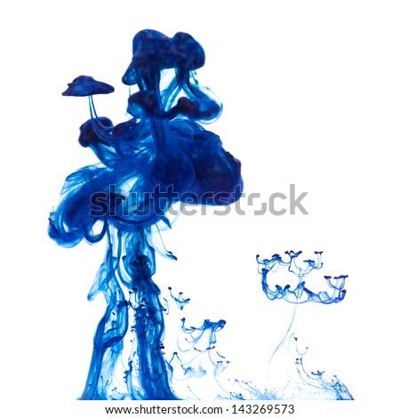 strange flora - drop of ink going thrppugh water - stock photo