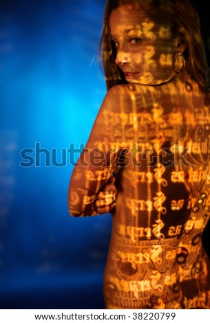 Strange girl portait in blue fog; Antique engraving and my abstract picture on her skin. - stock photo