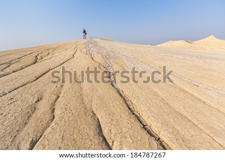 Strange landscape produced by active mud volcanoes in Buzau, Romania - stock photo
