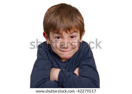 Strange looking kid - angry or just mischievous - stock photo