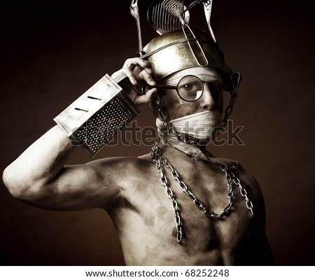 Strange man with pot on his head over dark background - stock photo