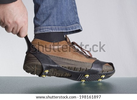 strap on shoe spikes - stock photo