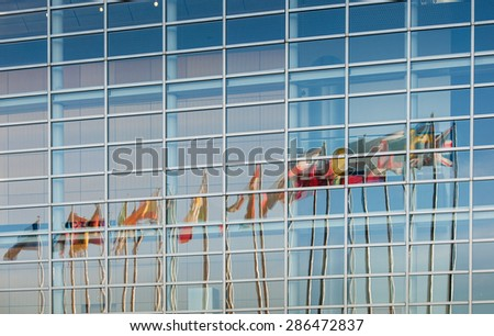 STRASBOUG, FRANCE - JANUARY 28, 2014: All European Union member countries flags reflected in European Parliament facade in Strasbourg, France, Alsace - stock photo