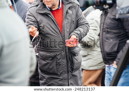 STRASBOURG, FRANCE - 28 JAN 2015 Man at protest holding phone with Turkey symbol on it - stock photo