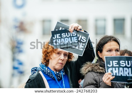 STRASBOURG, FRANCE - JANUARY 09, 2015: Council of Europe employees holding JE SUIS CHARLIE poster during a silent vigil to condemn the gun attack at French satirical magazine Charlie Hebdo in Paris - stock photo
