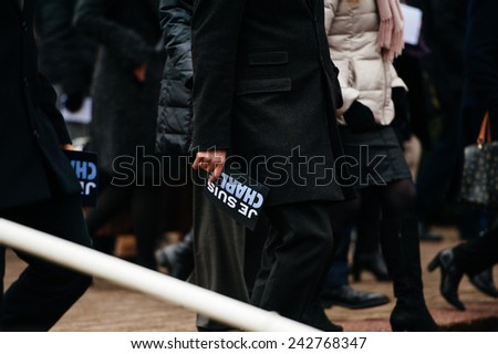 STRASBOURG, FRANCE - JANUARY 09, 2015: Man holding Je Suis Charlie poster after attending a silent vigil to condemn the gun attack at French satirical magazine Charlie Hebdo, which killed 12 people - stock photo