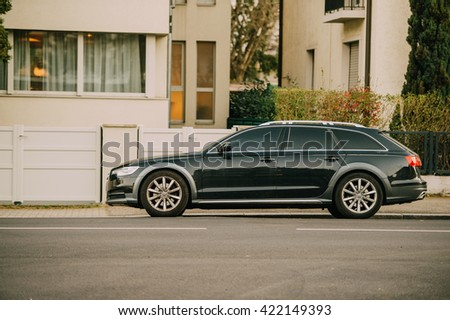 STRASBOURG, FRANCE - MARCH 18, 2016: AUDI wagon car parked in front of luxury house - stock photo