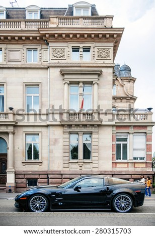 STRASBOURG, FRANCE - MAY 16, 2015: Chevrolet Corvette ZR 1 luxury sport car parked in front of historic building hotel. Between 2008-2014 only 4,684 were produced. - stock photo