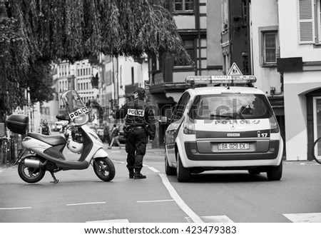 STRASBOURG, FRANCE - MAY 19, 2016: French police officer securing roate during a demonstrations against proposed French government's labor and employment law reform - stock photo