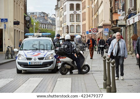 STRASBOURG, FRANCE - MAY 19, 2016: Police surveilling protest during a demonstrations against proposed French government's labor and employment law reform - stock photo