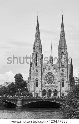 STRASBOURG, FRANCE - MAY 19, 2016: Pont d'Auvergne with people during demonstrations against proposed French government's labor and employment law reform - stock photo