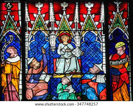 STRASBOURG, FRANCE - MAY 9, 2015: Stained glass depicting Christ aged twelve among the Doctors in the Temple of Jerusalem, in the cathedral of Strasbourg, France - stock photo