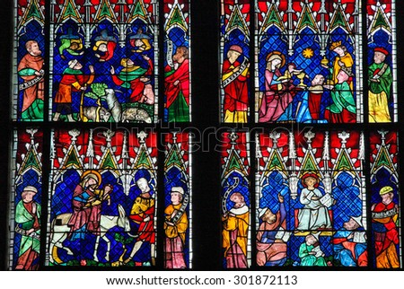 STRASBOURG, FRANCE - MAY 9, 2015: Stained glass depicting The Adoration of the Magi, the Flight into Egypt and Christ in the Temple of Jerusalem, in the cathedral of Strasbourg, France - stock photo
