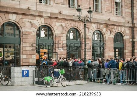 STRASBOURG, FRANCE - SEPTEMBER 19, 2014: Customers wait in line outside the Apple Inc. store during the sales launch of the iPhone 6 and iPhone 6 Plus in Europe, on Friday, Sept. 19, 2014 - stock photo