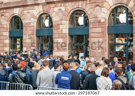 STRASBOURG, FRANCE - SEPTEMBER 19, 2014: Customers wait in line outside the Apple Inc. store during the sales launch of the iPhone 6 and iPhone 6 Plus in Europe - stock photo