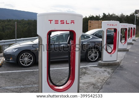 STRASBURG, VIRGINIA - DECEMBER 31, 2015: Tesla Superchargers with two Model S electric vehicles charging. - stock photo