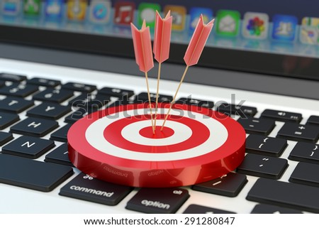 Strategic business solution and marketing strategy purpose concept, arrows in the center of a red target on laptop computer keyboard background - stock photo