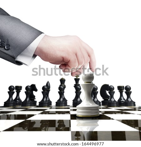 Strategy concept. hand holding white chess figure on chess board  isolated on white background High resolution  - stock photo