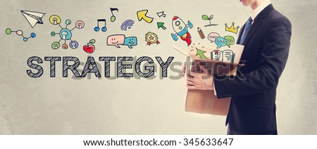 Strategy concept with Businessman holding a cardboard box - stock photo