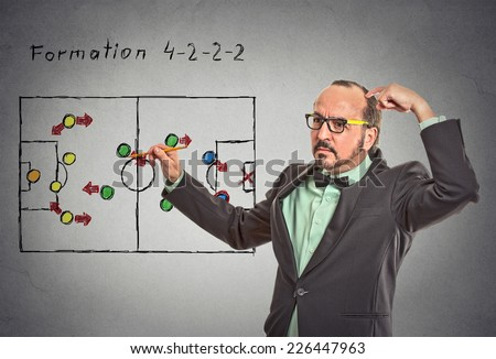strategy. Middle aged businessman leader thinking planning on next business plan proposition move isolated grey wall blackboard background. Face expression. Problem goal puzzle solution formation  - stock photo