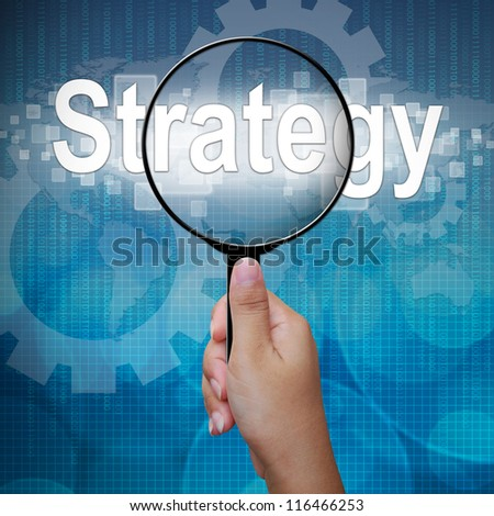 Strategy, word in Magnifying glass ,business background - stock photo