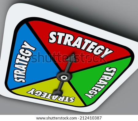 Strategy word on a board game spinner as your plan or turn to win the competition and achieve success in sports, business or life - stock photo