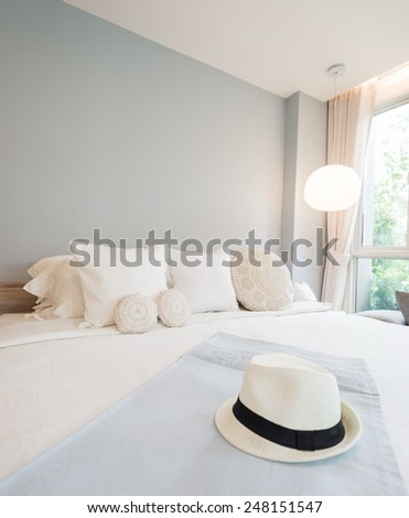 Straw hat on bed. ready for vacation - stock photo