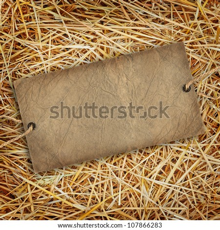 Straw texture background with cardboard label - stock photo