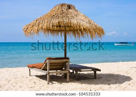 Straw umbrella on the beach of Cambodia - stock photo