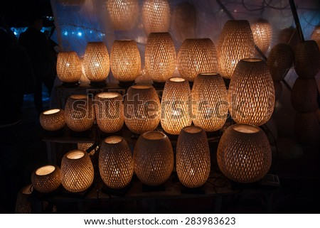 Straw woven lanterns in old Hoi An town in Vietnam. Background of ancient eastern culture. Straw wooven - stock photo
