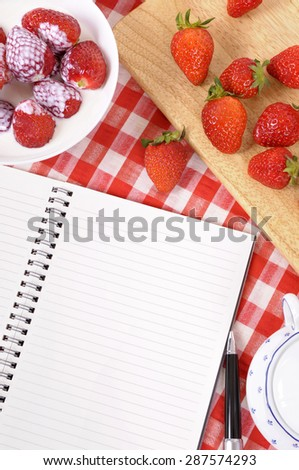 Strawberries and cream background, blank recipe book, copy space - stock photo