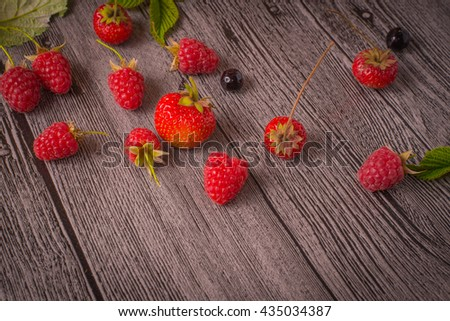 strawberries and raspberries on the table - stock photo