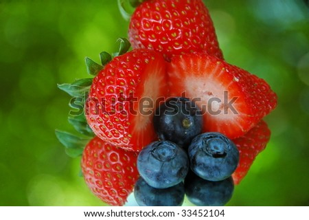 Strawberries & Blueberries outdoor reflection - stock photo