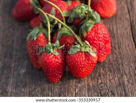strawberries fresh Placed on a wooden floor,goods strawberries,strawberries,red strawberries  - stock photo
