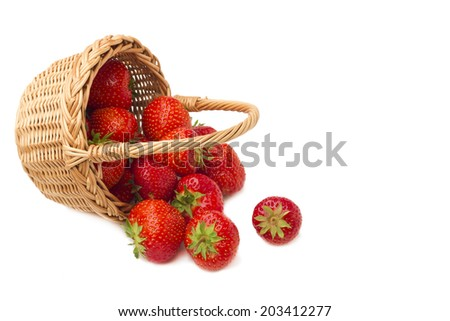 Strawberries in a basket. Isolated on white background. - stock photo