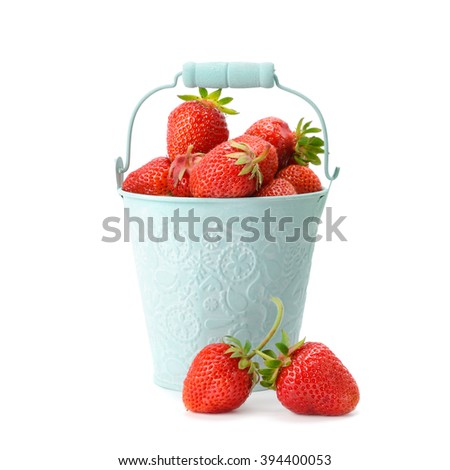 Strawberries in a bucket isolated on a white background - stock photo