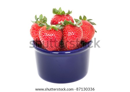 Strawberries in a ceramic blue bowl - stock photo