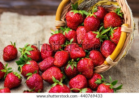 strawberries in basket, strawberry basket, strawberries on wooden table, strawberries on a brown background, basket with strawberries, strawberries in natural background - stock photo