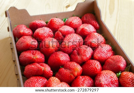 Strawberries in crate - stock photo