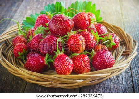 strawberries in natural wood background toning - stock photo